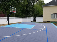 Residential backyard basketball court plus pickleball lines in Nashua, NH.