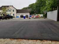 Home basketball court upgrade of old asphalt court in Cape Cod village of Pocasset in Bourne, MA. Shown here before any court upgrade work, old asphalt.