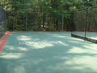 Restoration and resurfacing of large tennis court into multicourt with hopscotch and shuffleboard for a condo complex in Duxbury, Massachusetts. Separate area for kids, featuring hopscotch lines.