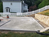 Cured concrete base being prepared to become a residential backyard basketball court in charcoal and titanium colors in Wellesley, MA.