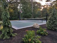 MA multiple sport court for basketball plus net games like badminton, tennis, and volleyball.