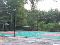 Pembroke, MA residential multiple-sport court in green and red low impact tiles.