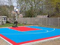 Light blue and red home game court for sports in Beverly, MA.