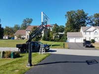 Driveway basketball hoop installation is the sort of thing you might find in Billerica, MA or a yard like yours.