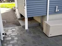 Detail of patio installed to supplement blue and grey basketball court with custom red H logo n Braintree, MA.