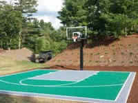 Green and silver home basketball court in Bridgewater, MA.