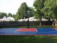 Navy and red backyard basketball court in Canton, MA.