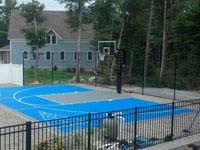 Overview of basketball and shuffleboard in blue and silver, integrated with pool deck and landscape in Wareham, MA.