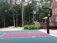 Backyard basketball court in Versacourt slate green and burgundy outdoor tile colors in Dartmouth, MA.