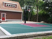 Small basketball court integrated with existing patio in Dartmouth, MA