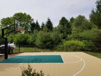 View of tan and green home basketball court in Easton, MA.