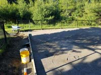 Packed sand, ready for us to pour cement for base of basketball court in Easton, MA.