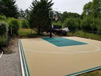 Off-white, tan, sand, beige, ecru? Whatever you call it, looks great with green on a home basketball court in Easton, MA.