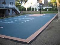 Large sport or game court surface for basketball or other games in Walpole, MA, installed on blacktop.