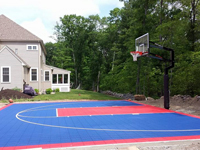 Backyard sport surface construction and basketball hoop installation in North Attleboro, MA.