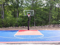 Navy blue and red backyard basketball court installation in North Attleboro, MA.