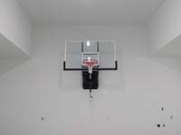 Basketball hoop installed on a garage wall.