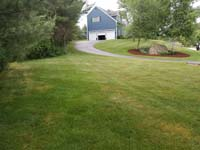 View of lawn that became the site of red and grey home basketball court in Groton, MA.