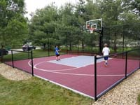 Youngsters shooting hoops on new home basketball court in Groton, MA.