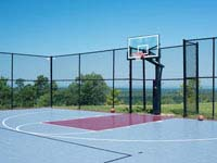 Large basketball court we resurfaced at GreatHorse Golf Club in Hampden, MA, using Versacourt Speed Outdoor Tile.