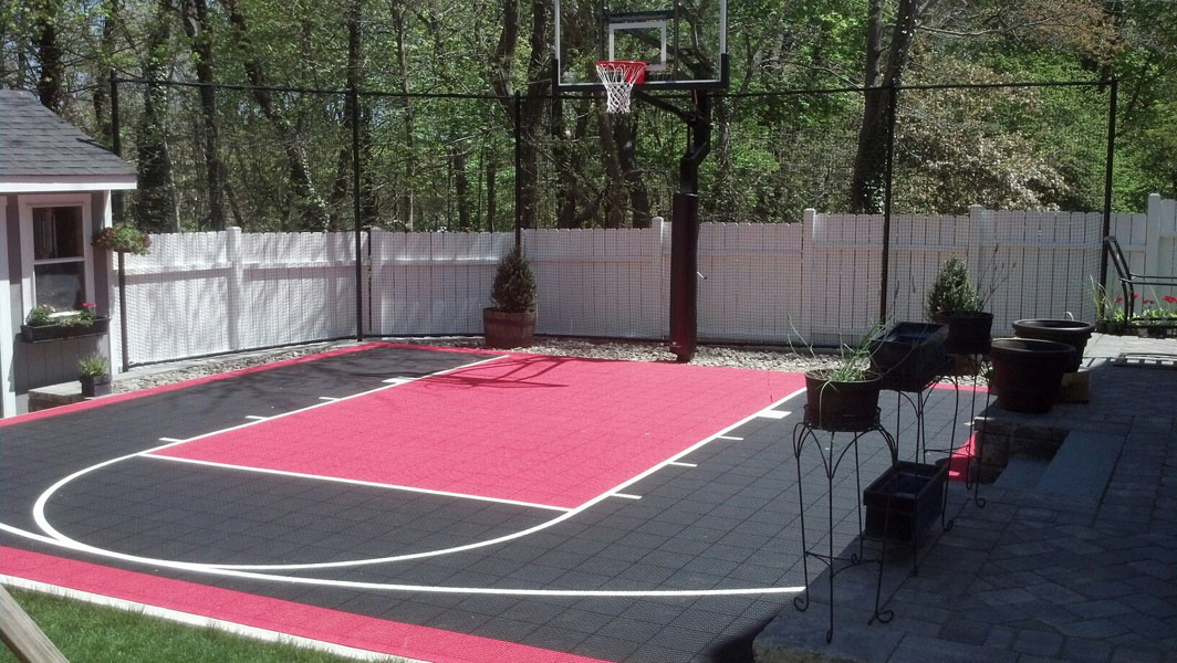 Home basketball court in Hingham, red and black, started in winter and finished early spring.