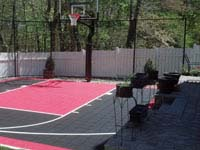 Black and red basketball court installed off-season in Hingham, MA. No need to wait for summer.