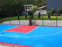 Light blue and red backyard basketball court installation in Hopedale, MA.