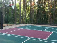 Green and burgundy home basketball court in Kingston, MA.