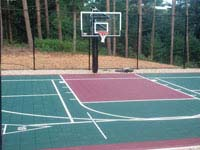 Focus on hoop side of basketball and multiple game or sport usage court in Kingston, MA.