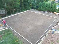 Next step is a form for the concrete base of a residential basketball court in shades of blue in Lexington, MA.