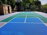 Existing grey, green and blue Versacourt to which we added new lines for pickleball and other sports besides basketball.