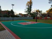 Rust and emerald green court with a custom logo, installed in Londonderry, NH.