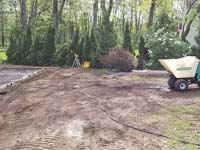 Form and cement moving machine ready to go to pour the base for a tan and green basketball court in Londonderry, NH.