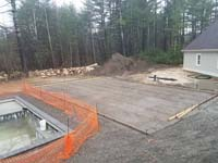 Form and reinforcement show prior to pouring cement base for green and black basketball court in Marion, MA.