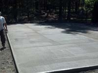 Curing the concrete base for a backyard basketball court in Kingston, MA.