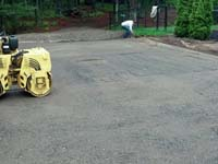 Preparing ground underlay for base for home basketball installation in Kingston, MA.