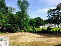Corner of a yard in West Bridgewater in the early stages of prep for home basketball court construction.