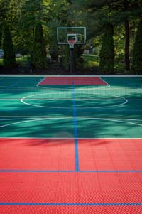 Large backyard multicourt for sports like basketball, tennis and volleyball in Pembroke, MA.