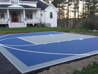 Quick Versacourt tile basketball surface on blacktop driveway in Plympton, MA.