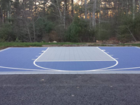 Navy blue and titanium court tiles installed on blacktop driveway in Plympton, MA.