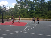Town basketball court after complete resurfacing and renovation in Plympton, MA.