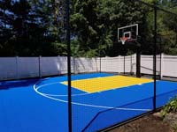 Royal blue and yellow basketball court and accessories in Stoneham, MA.s