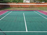 Backyard basketball court in Sudbury, MA, focusing on optional net making it a multicourt for tennis and volleyball.