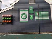 Backyard basketball court is the sort of thing you might find in Wakefield, MA or a yard like yours. Showing off customer embellishments to their court area, with basketball rack, Celtics banners, and Larry Bird shirt.