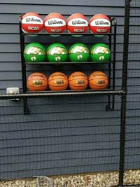 Backyard basketball court is the sort of thing you might find in Wakefield, MA or a yard like yours. Featuring closeup of basketball rack personalization by customer.