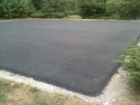 Blacktop surface ready for installation of large basketball court in Walpole, MA.