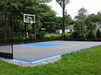 Graphite and light blue residential backyard basketball court in West Bridgewater, MA.