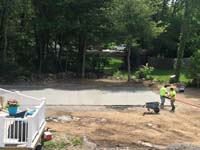 Cement poured, smoothed and waiting to cure for base of basketball court being built in West Bridgewater, MA.