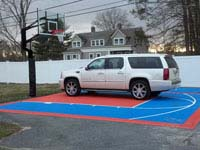 Car parked on court tiles installed on existing asphalt near Cape Cod.