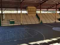 Resurfaced ABBA (Antigua and Barbuda Basketball Association) basketball court and replaced hoops at JSC Sports Complex in Piggotts, Antigua and Barbuda. Shown before resurfacing started, looking across court.